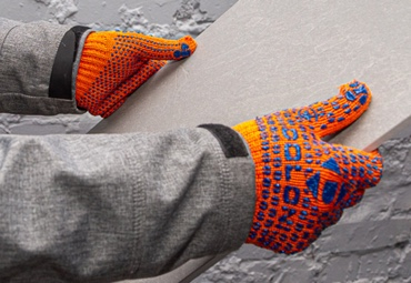 Knitted gloves with PVC pattern
